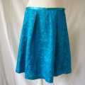 We added a satin waistband and cut the skirt pattern from the off-cut