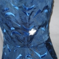 Early 1960s vintage satin dress had a hole at the side